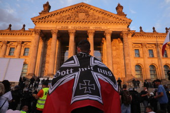 Protesters are seen outside the Reichstag with a flag of the German Reich of 1871-1918 during protests against coronavirus-related restrictions.