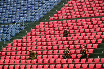 Police officers wearing masks sit in the stands as the Matildas played Vietnam in a match that was closed to the public.