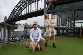 """Dan and Amalie Knox with their son Darcy and """"scout"""" the dog at Pier One which they are having a staycation."""