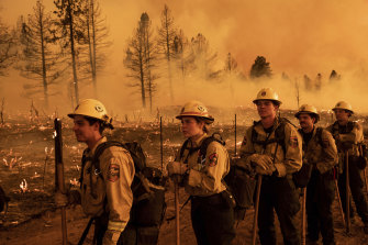 Firefighters from the California Department of Forestry and Fire Protection's Placerville station battle a blaze in Doyle.