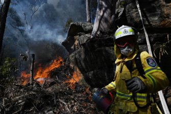 RFS Firefighter Jade Garrett from Killara brigade takes part in a  hazard-reduction burn in Westleigh, in Sydney's north.