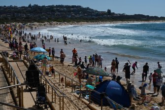 Crowds throng Dee Why Beach on Monday.