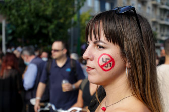 A woman sports an anti-fascist face marking during a protest outside the Golden Dawn trial in Athens, Greece.