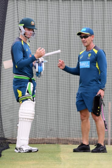 Handscomb talks with national coach Justin Langer in the nets.