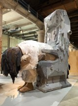 Yin Xiuzhen's six-metre high, hollow Trojan is covered with used cotton shirts.
