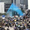 Petrol bombs, tear gas and blue dye: Police and protesters clash on streets of Hong Kong