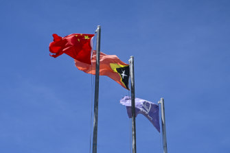 A Chinese and a Timorese flag fly at a workers' camp near the town of Zumalae, East Timor.