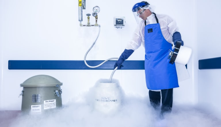 A technician prepares a transportation container at the Novartis lab in the US that reprograms immune cells.