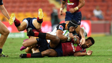 Christian Lealiifano of the Brumbies (top) is stopped by Samu Kerevi of the Reds.