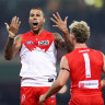 AFL keen to reunite Swans and Giants with families