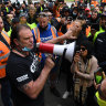 Building worker sacked, allegedly under union pressure, for attending protest