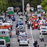 Protesters block Perth city bridge as they march for action on climate change