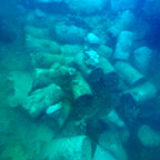 Nearly 200 depth charges in the cargo hold of a Japanese shipwreck in Koror harbour, Palau. The charges are still in situ underwater today. It's estimated that if they were to detonate, the destruction radius would be two kilometres and the shockwave radius would be 8 kilometres.
