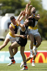 Max King, centre, attempts to mark the ball during St Kilda's intra-club match.