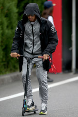 Hamilton scoots around the F1 Paddock in Japan earlier this month.