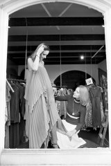 Dressing a model at her first boutique, in Sydney's Surry Hills, in 1975.