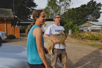 Plenty residents Ben, Lydia and their dog Eli prepare to evacuate their Mackelroy Road home ahead of a wind change.