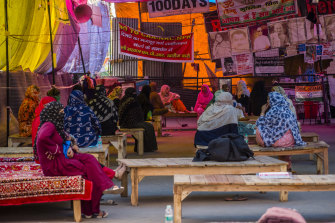 Protesters continue their sit-in demonstration while practising social distancing in New Delhi on Monday.