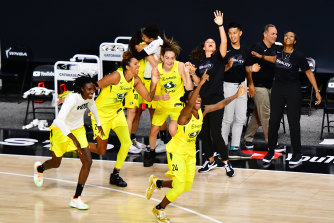 The Seattle Storm celebrate their championship win.