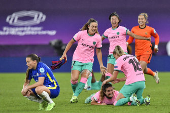 Barcelona players celebrate their first Women's Champions League crown.