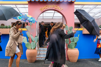It's up with the umbrellas and down with the rain on Stakes Day.