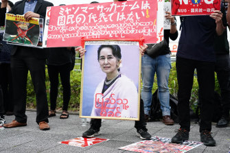 Myanmar citizens protest in Japan holding a picture of ousted leader Aung San Suu Kyi.