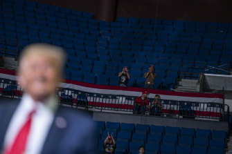 Trump supporters cheer as the US President speaks during a campaign rally in Tulsa.
