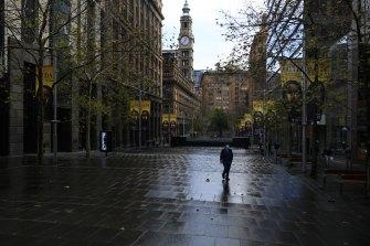 A pedestrian walks through an almost empty Martin Place this week.