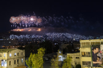 Fireworks explode over Qasioun Mountain as Syrian President Bashar al-Assad supporters celebrate his re-election.