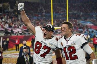 Brady and his title-winning teammate Rob Grownkowski.