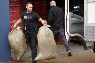 Police remove bags of marijuana after a raid in Carrum on Wednesday.