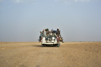 Migrants head towards Libya from Agadez, Niger in 2018. The desert is a common route for migrants seeking passage to Europe.