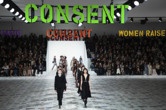 'Consent' signs were hung above the catwalk at Dior, where designer Maria Grazia Chiuri drew from her formative years.
