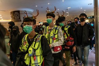 Volunteer medics stay close at hand during a demonstration inside a shopping mall on December 24 in Hong Kong.