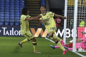 Gabriel Martinelli, right, celebrates the goal which kept Arsenal in the hunt for an unlikely European spot.