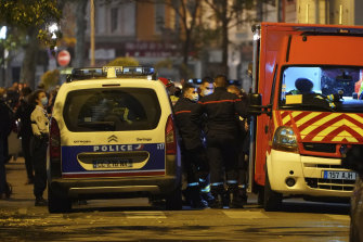 Police officers and rescue workers block the access to the scene after a Greek Orthodox priest was shot while he was closing his church in the city of Lyon, central France.
