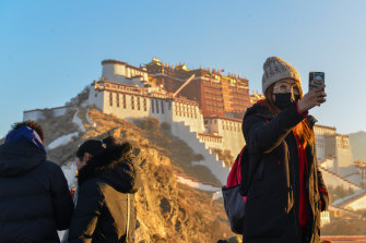 Tourists at the Potala Palace in Lhasa: the winter palace of the Dalai Lama since the 7th century, it is a UNESCO World Heritage site. The Dalai Lama lives in exile in India.