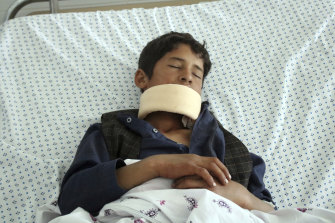 A wounded youth receives treatment at a hospital after gunmen stormed a mosque late on Tuesday, killing some worshipers and wounding several others, in Parwan province, north of Kabul, Afghanistan, on Wednesday, May 20, 2020.