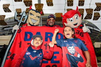 Demons fans show their support during the 2021 AFL Preliminary Final at Optus Stadium.