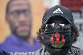 A protester marches at a rally in Minneapolis.