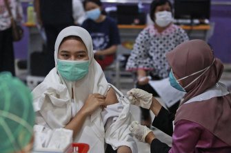 Indonesia is ramping up its vaccination program but does not yet have enough to innoculate its 270 million people.