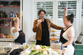 MKR contestants Jenni and Louise in the kitchen with Colin Fassnidge.
