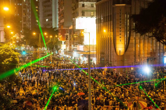 Pro-democracy protesters shine laser pointers during a clash at Admiralty district in Hong Kong on August 31.
