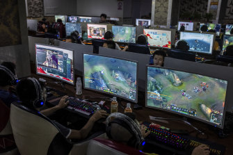 People playing video games last year at an internet cafe in Wenzhou, China. The Chinese government censors the country's internet.