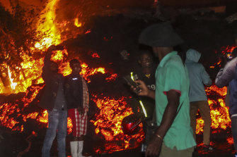 Residents take selfies in front of lava from the eruption of Mount Nyiragongo on the outskirts of Goma, Congo.