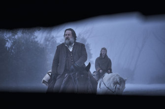 Harry Power (Russell Crowe) and young Ned (Orlando Schwerdt) glimpsed through a slit in Harry's hideaway.