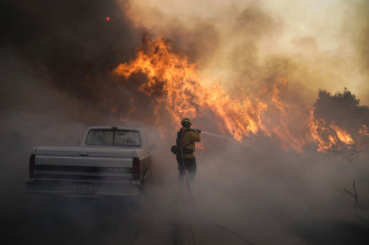 Firefighter Raymond Vasquez battles the Silverado Fire Monday, Oct. 26, 2020, in Irvine, California