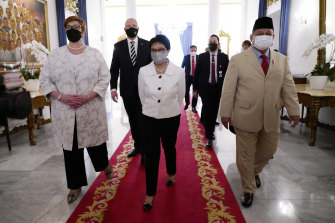 Foreign Minister Marise Payne and Defence Minister Peter Dutton walk with their Indonesian counterparts in Jakarta, Indonesia.