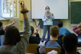Teacher Julia Rakow wears a protective face mask as she leads a class in the origins of German poetry at Sophie-Charlotte Gymnasium high school in Berlin, Germany earlier this month.