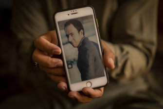Amal Ahmadi, 32, holds a picture of his slain brother Zemerai Ahmadi at the family house in Kabul, Afghanistan, Monday, September 13, 2021.